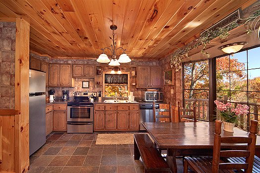 kitchen with stainless appliances at hidden pleasure a 1 bedroom cabin rental located in gatlinburg