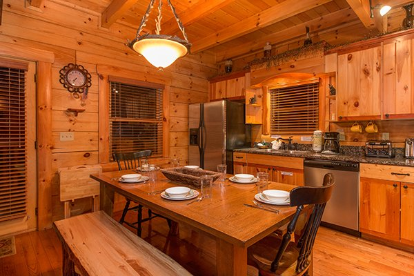 Dining table with seating for six in the kitchen at Bearfoot Paradise, a 3-bedroom cabin rental located in Pigeon Forge