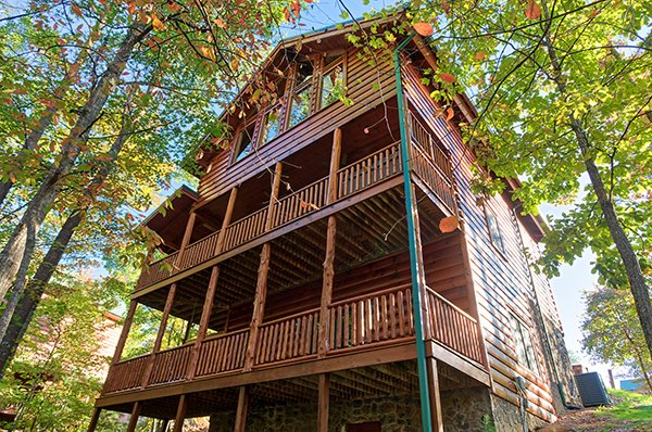 Looking up at two levels of deck at Bearfoot Paradise, a 3-bedroom cabin rental located in Pigeon Forge