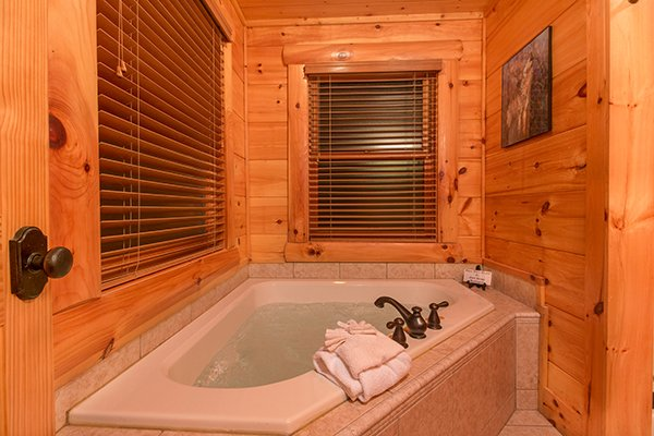 Corner jacuzzi tub at Bearfoot Paradise, a 3-bedroom cabin rental located in Pigeon Forge