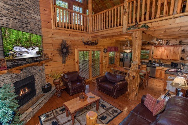 Open concept living room with a loveseat and recliner at Bearfoot Paradise, a 3-bedroom cabin rental located in Pigeon Forge