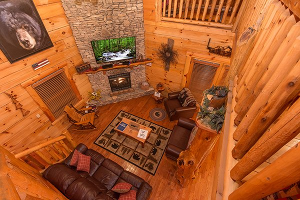 Looking down into the living room from the second floor at Bearfoot Paradise, a 3-bedroom cabin rental located in Pigeon Forge