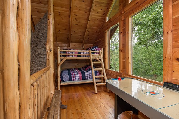 Loft bunks at Bearfoot Paradise, a 3-bedroom cabin rental located in Pigeon Forge