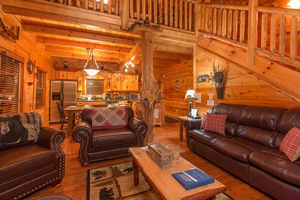 Leather sofa and two chairs in the open concept living room at Bearfoot Paradise, a 3-bedroom cabin rental located in Pigeon Forge