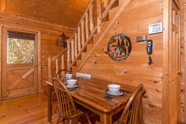 Dining table for three at Lincoln Logs, a 2 bedroom cabin rental located in Gatlinburg