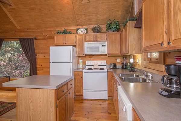 Kitchen with white appliances at Lincoln Logs, a 2 bedroom cabin rental located in Gatlinburg