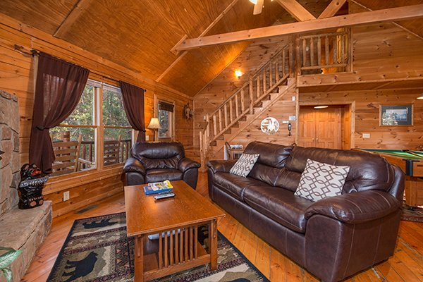 Sofa and large chair in the vaulted living room at Lincoln Logs, a 2 bedroom cabin rental located in Gatlinburg
