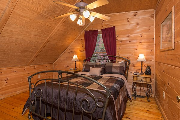 Bedroom with a queen bed at Lincoln Logs, a 2 bedroom cabin rental located in Gatlinburg