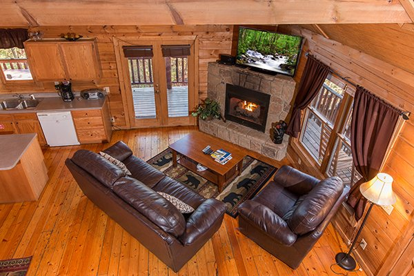 Looking down onto the living room from the upper floor at Lincoln Logs, a 2 bedroom cabin rental located in Gatlinburg