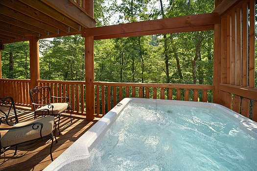Hot tub on deck at Cozy Creek, a 3-bedroom cabin rental located in Pigeon Forge