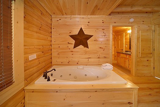 Jacuzzi tub in bedroom at Cozy Creek, a 3-bedroom cabin rental located in Pigeon Forge