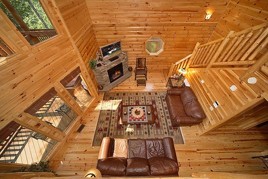 View of the living room from the lofted game room at Cozy Creek, a 3-bedroom cabin rental located in Pigeon Forge