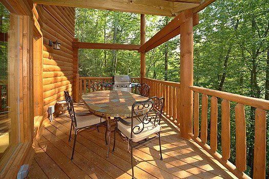 Patio dining on the deck at Cozy Creek, a 3-bedroom cabin rental located in Pigeon Forge