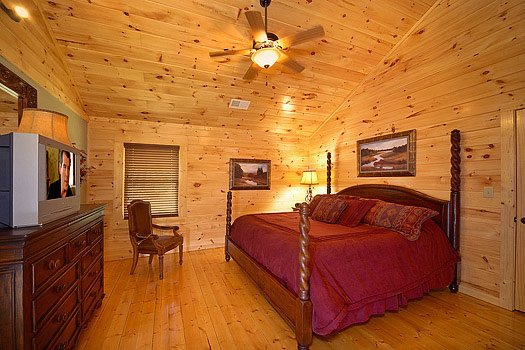 Second floor bedroom with king-sized bed at Cozy Creek, a 3-bedroom cabin rental located in Pigeon Forge