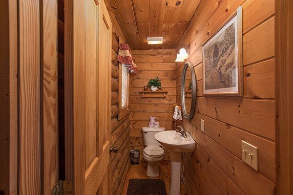 Half bath in the entryway at Hanky Panky, a 1-bedroom cabin rental located in Pigeon Forge