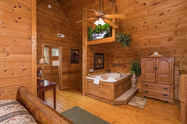 Jacuzzi in the loft bedroom at Hanky Panky, a 1-bedroom cabin rental located in Pigeon Forge