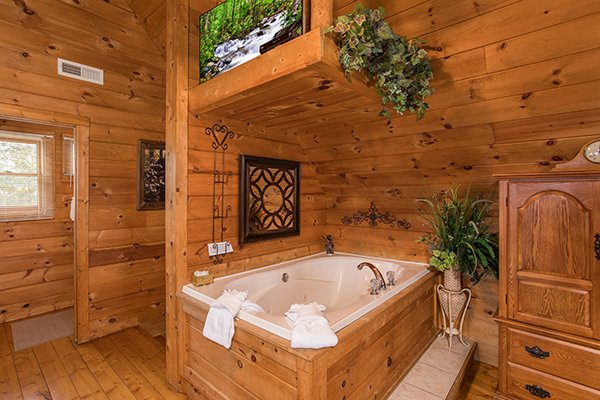 In room jacuzzi and a TV in the loft bedroom at Hanky Panky, a 1-bedroom cabin rental located in Pigeon Forge