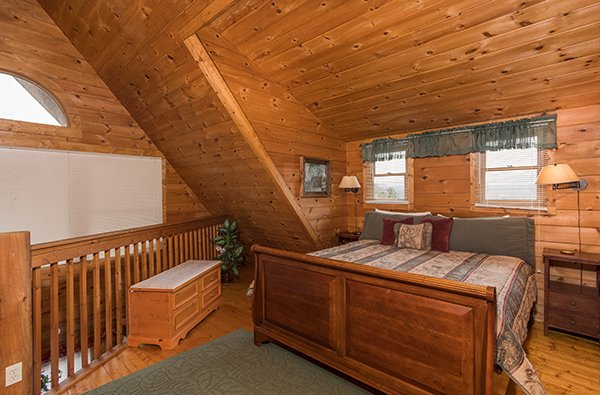 King-sized bed in the loft at Hanky Panky, a 1-bedroom cabin rental located in Pigeon Forge