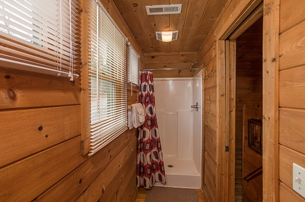 Shower stall in a bathroom at Hanky Panky, a 1-bedroom cabin rental located in Pigeon Forge
