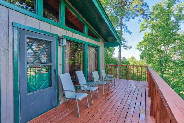 Main entrance and seating on the deck at Bushwood Lodge, a 3-bedroom cabin rental located in Gatlinburg