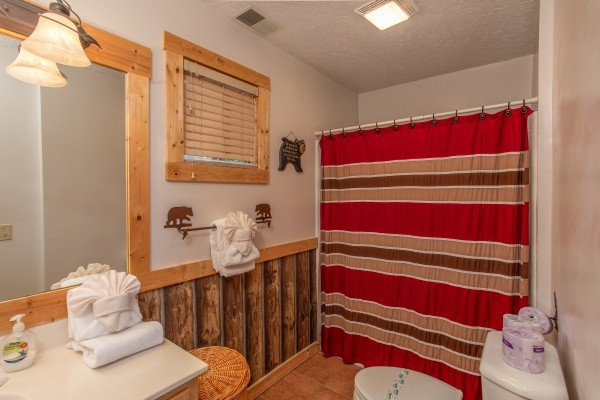 First bathroom at Bushwood Lodge, a 3-bedroom cabin rental located in Gatlinburg