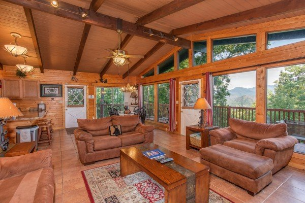 Vaulted living room with floor-to-ceiling windows at Bushwood Lodge, a 3-bedroom cabin rental located in Gatlinburg