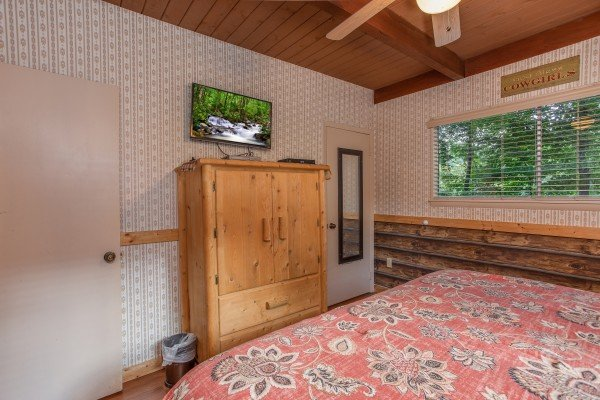 Second bedroom with a television and armoire at Bushwood Lodge, a 3-bedroom cabin rental located in Gatlinburg