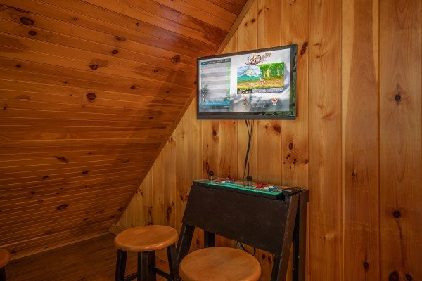 Arcade game and TV at Around the Bend, a 3 bedroom cabin rental located in Pigeon Forge