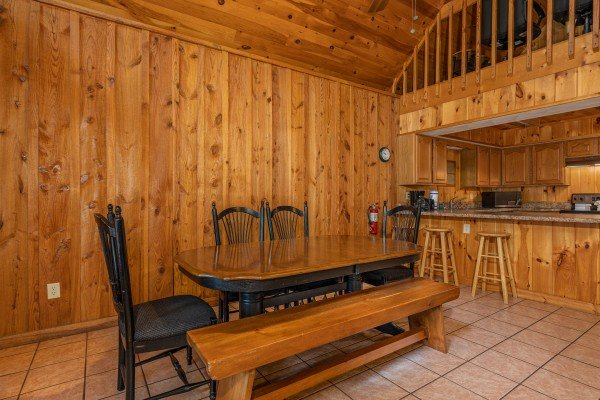 Dining table for six and a breakfast bar at Around the Bend, a 3 bedroom cabin rental located in Pigeon Forge