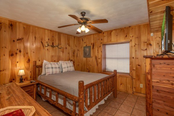 Bedroom with a queen bed and nightstand at Around the Bend, a 3 bedroom cabin rental located in Pigeon Forge
