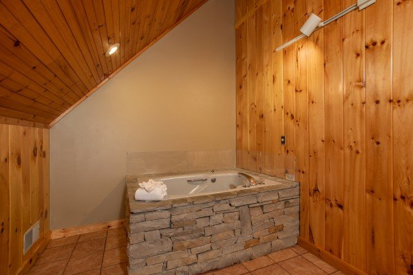 Jacuzzi in the loft bedroom at Around the Bend, a 3 bedroom cabin rental located in Pigeon Forge