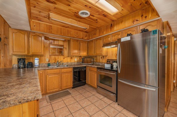 Kitchen with stainless appliances at Around the Bend, a 3 bedroom cabin rental located in Pigeon Forge