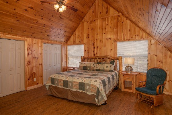 Loft bedroom with glider chair at Around the Bend, a 3 bedroom cabin rental located in Pigeon Forge