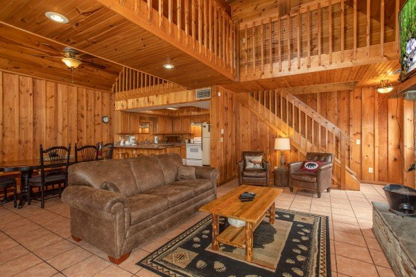 Main floor with living and dining space at Around the Bend, a 3 bedroom cabin rental located in Pigeon Forge
