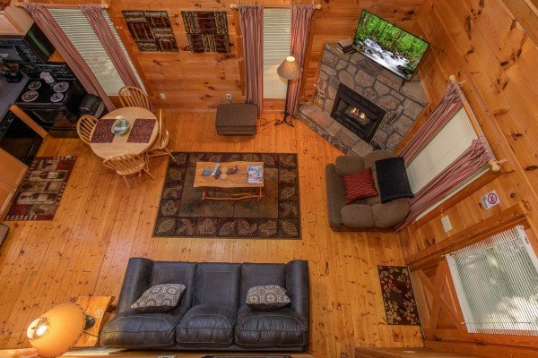 Looking down into the living room at Swept Away in the Smokies, a 1 bedroom cabin rental located in Pigeon Forge