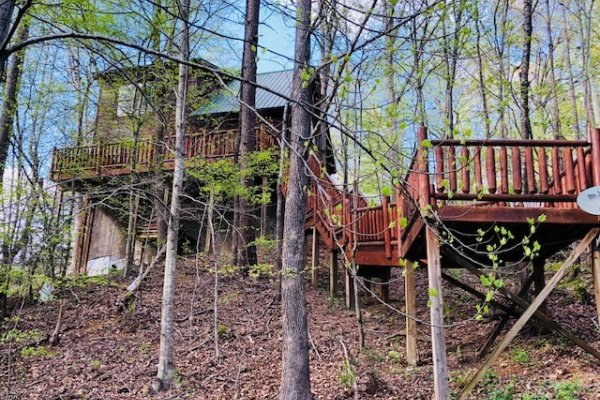 Looking back up at the deck at Swept Away in the Smokies, a 1 bedroom cabin rental located in Pigeon Forge