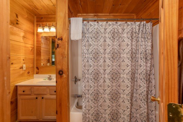 Bathroom with a tub and shower at Swept Away in the Smokies, a 1 bedroom cabin rental located in Pigeon Forge