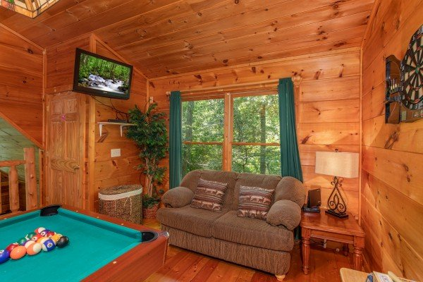 Game room with pool table and TV at Swept Away in the Smokies, a 1 bedroom cabin rental located in Pigeon Forge