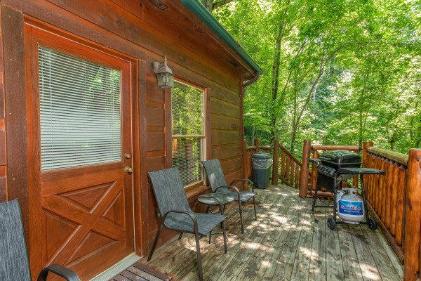 Grill on a deck at Swept Away in the Smokies, a 1 bedroom cabin rental located in Pigeon Forge