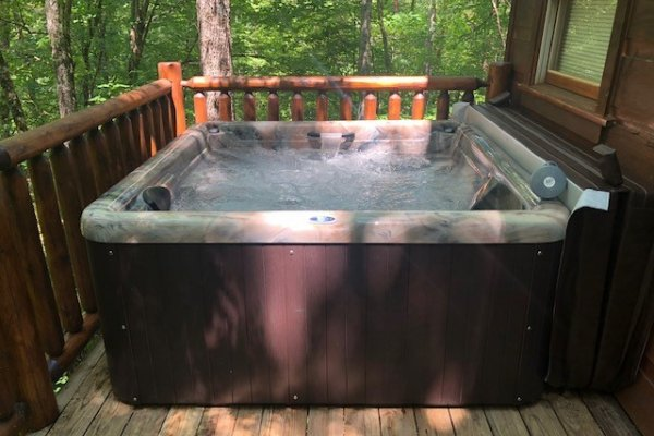 A new hot tub on the deck at Swept Away in the Smokies, a 1 bedroom cabin rental located in Pigeon Forge