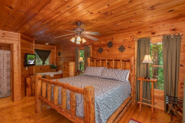 Bedroom with a king log bed at Swept Away in the Smokies, a 1 bedroom cabin rental located in Pigeon Forge