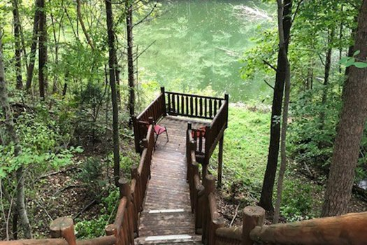 Smaller deck overlooking the stream at Swept Away in the Smokies, a 1 bedroom cabin rental located in Pigeon Forge