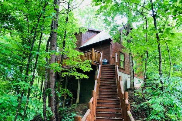Stairs up from the lower deck at Swept Away in the Smokies, a 1 bedroom cabin rental located in Pigeon Forge