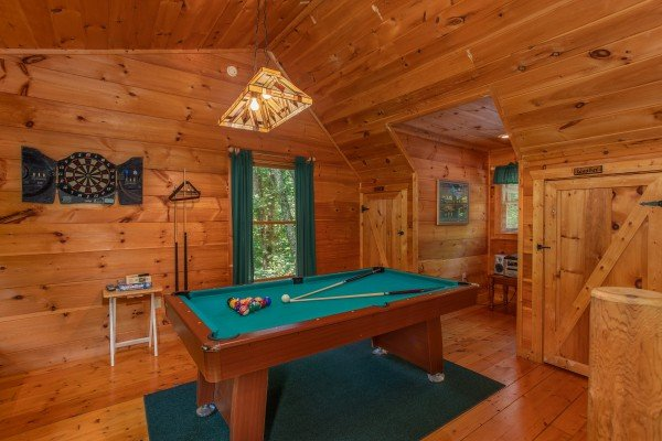 Pool table at Swept Away in the Smokies, a 1 bedroom cabin rental located in Pigeon Forge