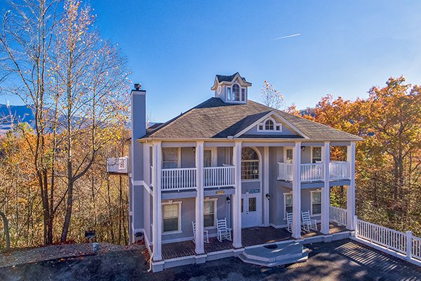 Drone exterior view at Chalet Mignon with fall colors and bright blue skies, an 8-bedroom cabin rental located in Gatlinburg