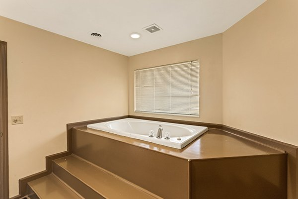 Jacuzzi tub at Chalet Mignon, an 8-bedroom cabin rental located in Gatlinburg
