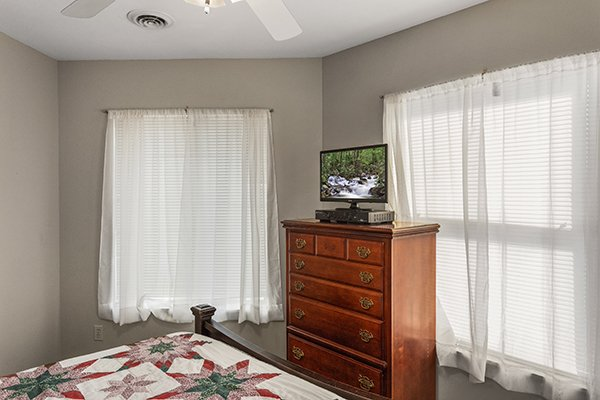Bedroom with a dresser and television at Chalet Mignon, an 8-bedroom cabin rental located in Gatlinburg