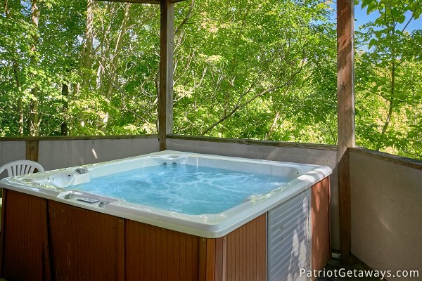 hot tub at chalet mignon a 8 bedroom cabin rental located in gatlinburg