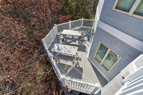 Looking down at the lower deck from an upper level deck at Chalet Mignon, an 8-bedroom cabin rental located in Gatlinburg