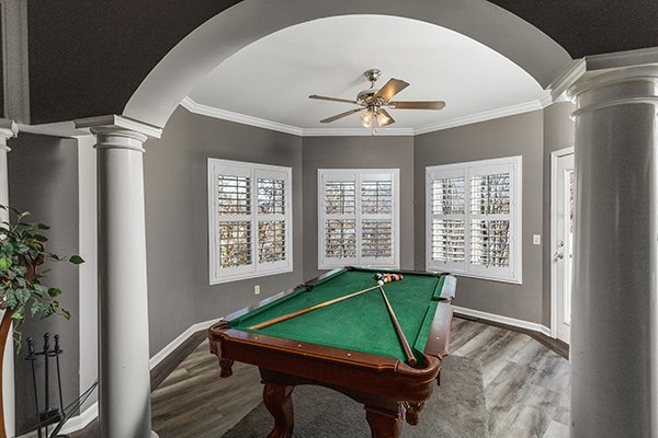 Pool table at Chalet Mignon, an 8-bedroom cabin rental located in Gatlinburg